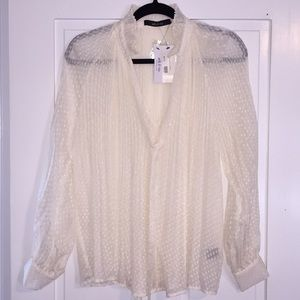 Lovely ivory blouse with all the details!